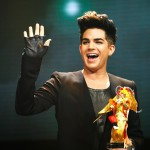 "Adam receiving the ""Most Popular International Artist"" at the CMAs"